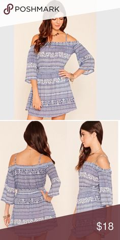 Boho cold shoulder dress Fun & flirty skater dress with an abstract floral design. Stretchy, smocked waistline & shoulders give it a figure flattering silhouette. EUC with no flaws. Note- dress seems a darker blue, but likely varies with monitors. Dresses