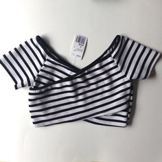Forever 21 Crop Top. NWT. Brand New Forever 21 Crop Top. Black and White Stripes. Criss Cross Front. Polyester/Spandex Blend. So Adorable but I Can Never Wear This...NWT. Forever 21 Tops Crop Tops