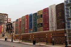 Creative parking garage of the Kansas City Public Library looks like a giant bookshelf filled with classic books.  The building was designed by Dimensional Innovations. Local residents selected the titles of the books that are displayed on the bookshelf.  [photos by David King and Jonathan Moreau]