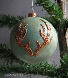 antler design christmas bauble in turquoise and copper