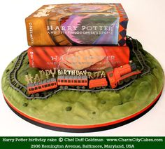 Harry Potter books & train birthday cake  © Chef DUFF GOLDMAN via his bakery website. Charm City Cakes, 2936 Remington Ave, Baltimore, Maryland, USA. Star of the TV series, Ace of Cakes.  More on Duff: http://WelcomeToBaltimoreHon.com/the-sweet-life-of-duff-goldman [Do not remove caption; required by international copyright law. Link directly to the firm's website.]   PINTEREST on COPYRIGHT:  http://pinterest.com/pin/86975836526856889/ http://www.pinterest.com/pin/86975836525507659/