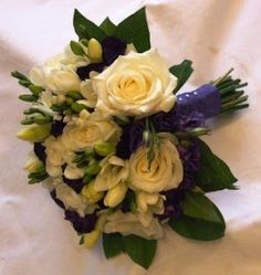Ivory roses and freesia with purple eustomas