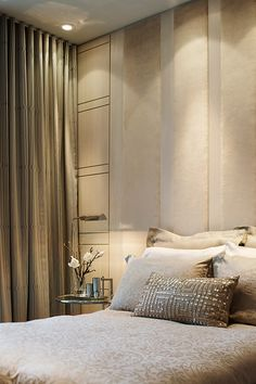 Love the monochromatic beige palette ... the sequined pillow kicks things up a notch! GLAM!!!