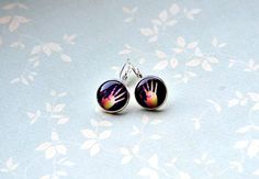 Hands design silver colored dangle glass cabochon by Anchy on Etsy, $8.50