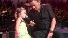 Our darling little grandaughter Nevaeh at her first Bruce concert. After the song Bruce came back over and asked how old she was and after hearing she was 4 ...