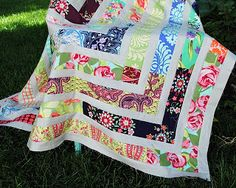 """Selvage Blog: Quilt by Hideaway Girl """" used a jelly roll of Amy Butler's Love fabric line with one Sis Boom print thrown in (see if you can figure out which one doesn't belong). The neutral strips are Kona Ash. This is a pattern I kind of made up as I went along. I cut the jellyroll strips in half so they were about 22"""" long and just randomly sewed them together into one long strip. I cut the Kona Ash strips 1 1/2"""" wide. And round & round I went, starting each new printed row where I left…"""