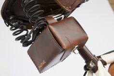 Leather saddle bag buckles to any bicycle saddle