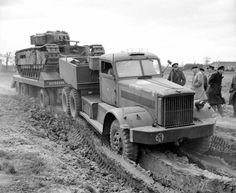 Diamond T tank-transporter towing a Churchill tank at the REME experimental recovery section at Aborfield, Berkshire, 7 April Army Vehicles, Armored Vehicles, Cool Trucks, Big Trucks, Train Truck, Tow Truck, Old Lorries, Military Pictures, Ww2 Tanks
