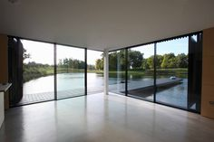 The contemporary Boat House project was constructed by the side of a lake using #slimframed #slidingglass doors by minimal windows® to make the most of the 360 degree countryside views. Our minimally framed sliding doors were designed to slide away from the corner with one side disappearing a hidden wall cavity, opening up the internal #livingareas to the surrounding lake and providing easy access to the decked #externalpatio areas. Aluminium Sliding Doors, Sliding Door Systems, Sliding Glass Door, Glass Doors, Home Renovation, Luxury Homes, Minimalism, Outdoor Living, Living Spaces