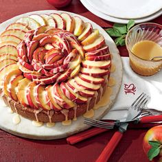 Caramel Apple Cake | MyRecipes.com This cake is topped with sautéed apple slices and drizzled in a delicious Apple Brandy-Caramel Sauce.