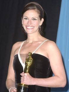 Looking like she stepped right out of old Hollywood, Julia Roberts accepted her first Academy Award -- in vintage Valentino -- for her role in Erin Brockovich on March 25, 2001. Roberts swept awards season that year and also picked up a Golden Globe, a People's Choice award, a SAG and even an MTV Movie Award for playing the real-life crusader.    Read More http://www.ivillage.com/pictures-julia-roberts-through-years-2001/1-b-396506#ixzz2B8UGuwPP  Sign up for iVillage Special Offers