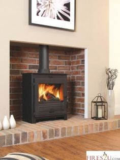 The Flavel No. 2 Multi fuel stove is a contemporary steel stove which features a large viewing window and is exceptionally easy to operate. House Design, Home Living Room, Brick Hearth, Front Room, Fireplace Design, New Living Room, New Homes, Log Burner Living Room, Exposed Brick Fireplaces