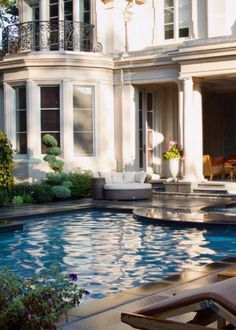 house backyard with pool and juliet balcony