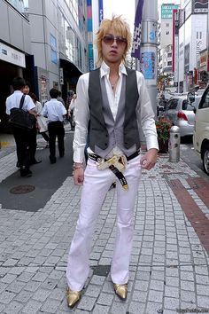 Gold Gun Belt Buckle by Shibuya // This is a ridiculous picture and I love it.