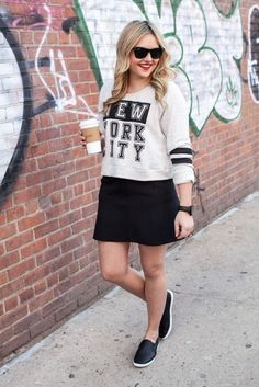 A cute sweatshirt and slip-on shoes make a mini-skirt more casual.
