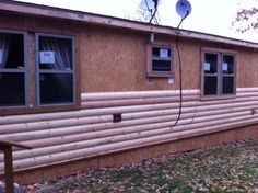 manufactured home remodel - new siding being installed