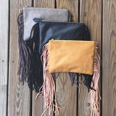 Seriously, we cannot get enough of fringe this fall! These clutches are the perfect accessory!  | Fringe clutch {$48} | #remiandreid #fringe #shoplocal #juneandbeyond #clutches #fallfashion #fall2015 #essentials