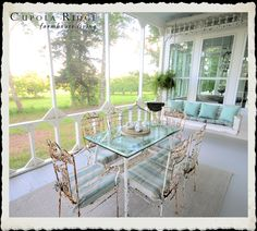 Vintage porch swing, chippie rusty iron table and chairs for the screened-in porch at the new farmhouse.