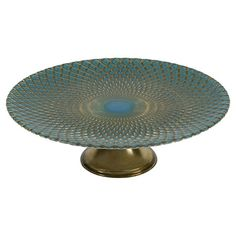 Glass cake stand with a textured diamonds design.   Product: Cake standConstruction Material: Glass...