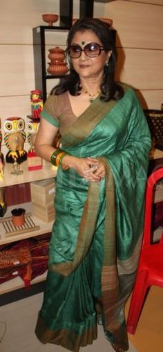 Tollywood Actress Aparna Sen in a green and mustard-brown sari