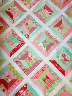 cheerful quilt-as-you-go strip quilt, by jera brandvig of the quilting in the rain blog