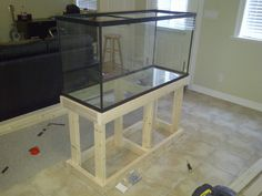 Aquarium Stand (first build) - Imgur http://www.reddit.com/r/woodworking/comments/pegpe/90_gallon_aquarium_stand_first_project/
