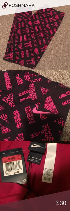 NIKE leggings NWT NWT nike tight fit leggings. Im 5'2 and they hit my ankle. They are all black with a dark pink/raspberry color design. Nike check logo. Size large in women's. No flaws. Never worn NWT. Nike Pants Leggings
