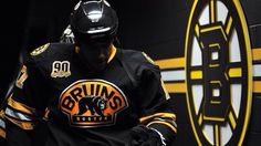 Milan Lucic walking out next to the Bruins' logo Hockey Room, Hockey Teams, Milan Lucic, Dont Poke The Bear, Boston Bruins Hockey, Boston Sports, Colorado Avalanche, Home Team, Sport Wear