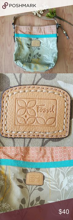 Fossil tote purse Very pretty purse.  It measures 14 inches across and 15 inches tall.   There is a tiny spot on the bottom which I have pictured.  Over all in great pre-owned condition.  Thanks for looking Fossil Bags Totes