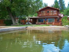 Waitts Lake Waterfront Home 50' frontage, 3 bed (1 non-conforming), 2 bath, 2193 sq ft, office, bonus room, living room with lake views, remodeled in 2004, 3 propane fireplaces, 2 car attached garage, hot tub, fire pit, level lot, private yard, sandy beach & dock.