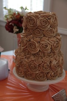 Wedding cake of espresso and double chocolate espresso layers filled with creamy coffee filling, covered with dark chocolate ganache, with piped espresso buttercream roses