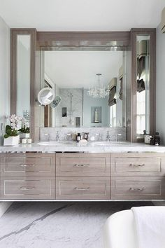 Floating gray washed wood bathroom vanity with metallic trim detail. Love this traditional meets feminine look.