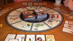 I made a circular game board for Munchkin. Made with Xara Designer and had it professionally printed and mounted - wasn't expensive at all.