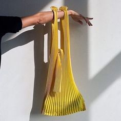 Yellow lightweight pleated bag made from biodegradable corn based PLA (Polylactic Acid Fiber) Two straps with tie closure To maintain pleats, empty the bag after use Hand wash, do not tumble dry 22 x 30 inches Made in Fukui, Japan From KNA Plus Look Fashion, Fashion Bags, Fashion Design, Lv Bags, Purses And Bags, Sacs Design, Diy Vetement, Clutch, Mellow Yellow