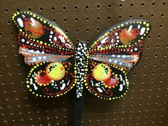 Butterfly stake sign created by adults with intellectual and developmental disabilities.