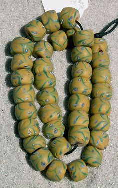African Trade Beads |  Rare Venetian fancy beads dating to the beginning of the 20th century. | These beads are hand painted in a green, blue and white decoration.