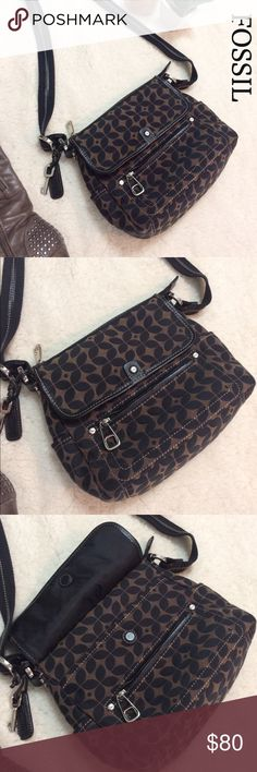 Fossil Black and Brown Crossbody - NWOT Brand new and exceptionally cute for the upcoming Season. It has a magnetic flap and pocket in front along with a zippered pocket. The back has another open pocket and there is a zippered interior compartment. The strap can adjust from crossbody to shoulder bag as well. Fossil Bags Crossbody Bags
