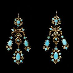 1830: This pair of earrings and the associated necklace were given to Anne, Lady Hunloke (1788-1872) by William, 6th Duke of Devonshire (1790-1858). They are in a style which was fashionable around 1830 using turquoise, possibly from Russia and cannetille (rolled and twisted) gold.