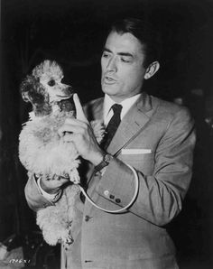 Check out this image from TCM.   Medium BTS shot of Gregory Peck as Mike Hagen holding dog.