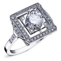 LEAH : Bague en or blanc style art deco sertie d'un diamant rond au centre et un…