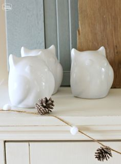 The Happy Housie January Blues Winter Mantel with white owls and pompom pinecone garland