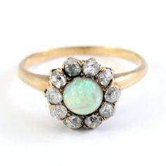 Victorian jelly opal ring with mine-cut diamonds.