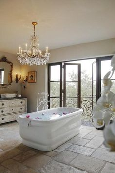 Traditional Master Bathroom with Flush, Simple granite counters, Single sink, Gold and crystal chandelier, Master bathroom