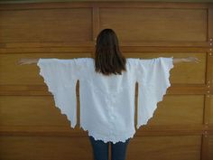 I made this blouse out of a vintage embroidered linen tablecloth. I made a little tutorial showing how to make a top like this out of any small round table cloth. See it here.