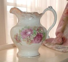 water pitcher with roses and lily of the valley