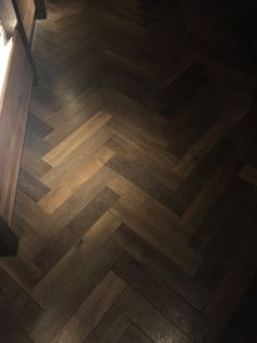TANGA. Deep smoked, brushed and hard wax oiled engineered oak herringbone parquet wood flooring. Suitable for commercial and residential installations and over under floor heating systems. #parquetflooringUK #parquet #herringboneparquet #woodenfloors #engineeredwoodflooring #herringboneflooring #interiors
