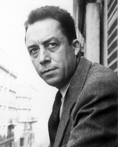 """Portrait of Camus on forearm, bordered by """"one must imagine Sisyphus happy"""""""