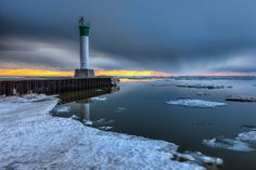 A winter like sunset image from early spring in Grand Bend Ontario. Sunset Images, Winter Sunset, O Canada, Early Spring, Colouring Pages, Ontario, Lighthouse, Houses, Paintings