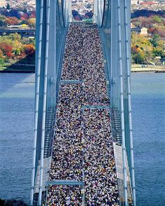 For #globalrunningday day an on assignment shot for @natgeo - a story on the limits of the human body. @joemcnallyphoto airview of start of #nyc #marathon #running #chopper #longlens