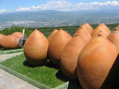 Kvevris in Georgia. Kvevris are large earthenware vessels used for the fermentation, storage and ageing of traditional Georgian wine. Resembling large, egg-shaped amphorae without handles, they are either buried below ground or set into the floors of large wine cellars. Kvevris vary in size: volumes range from 20 litres to around 10,000; 800 is typical. (V)